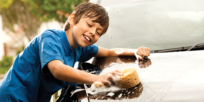 Boy Washing a car